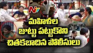 మహిళను జుట్టు పట్టుకొని బయటకు లాక్కెళ్లిన పోలీస్ | Bangalore Police Misbehaves with Woman